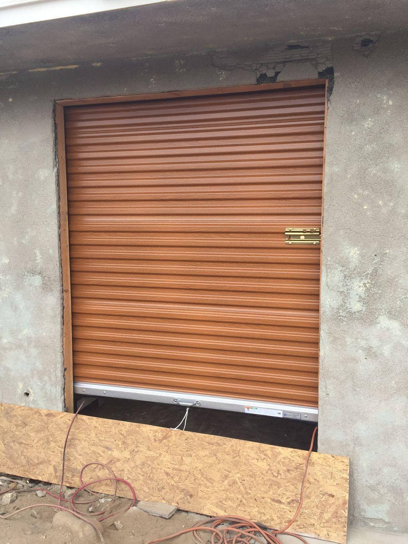 Secondary garage roll up door installed wood grain finish