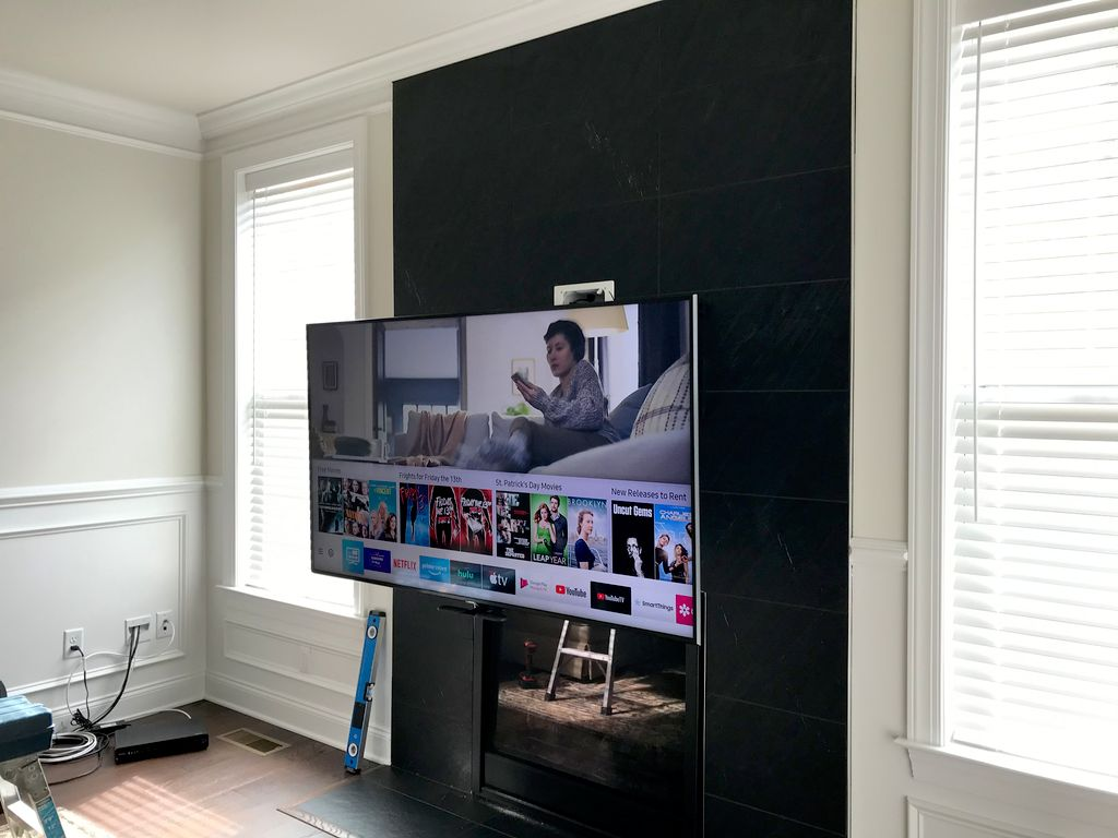 MantelMount 700 Pull Down Mount over Slate Fireplace
