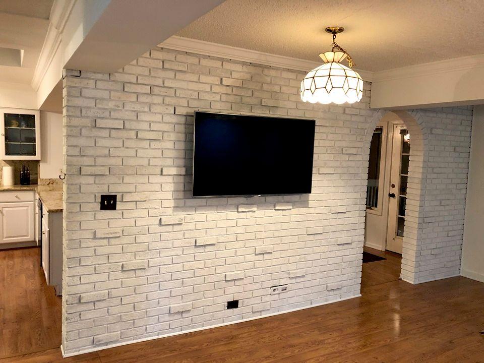 Brick wall TV mount and whitewash paint
