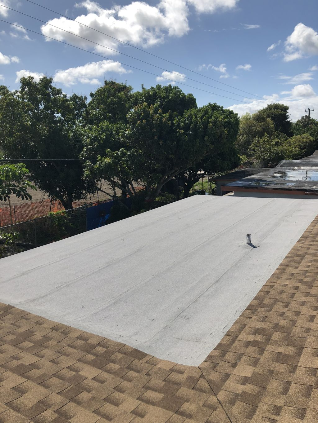 Shingle and flat roof re roof