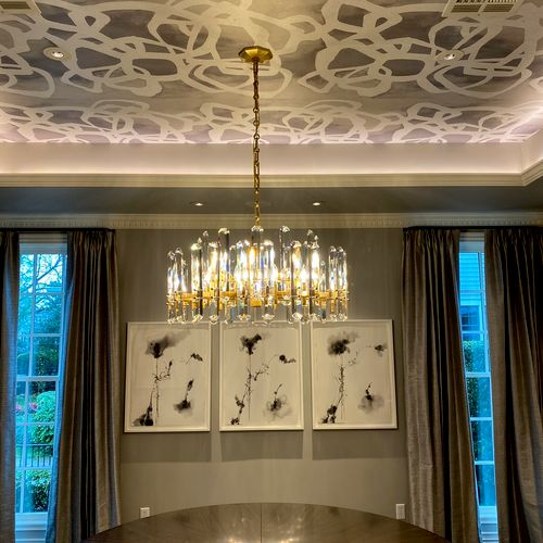 Cove ligthing and crystal chandelier.