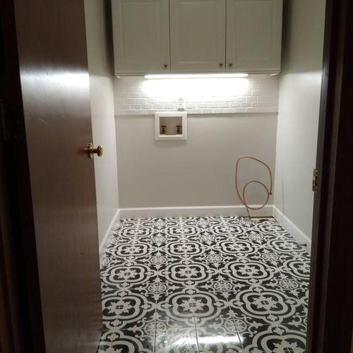 new tile floor, baseboards, tile backsplash