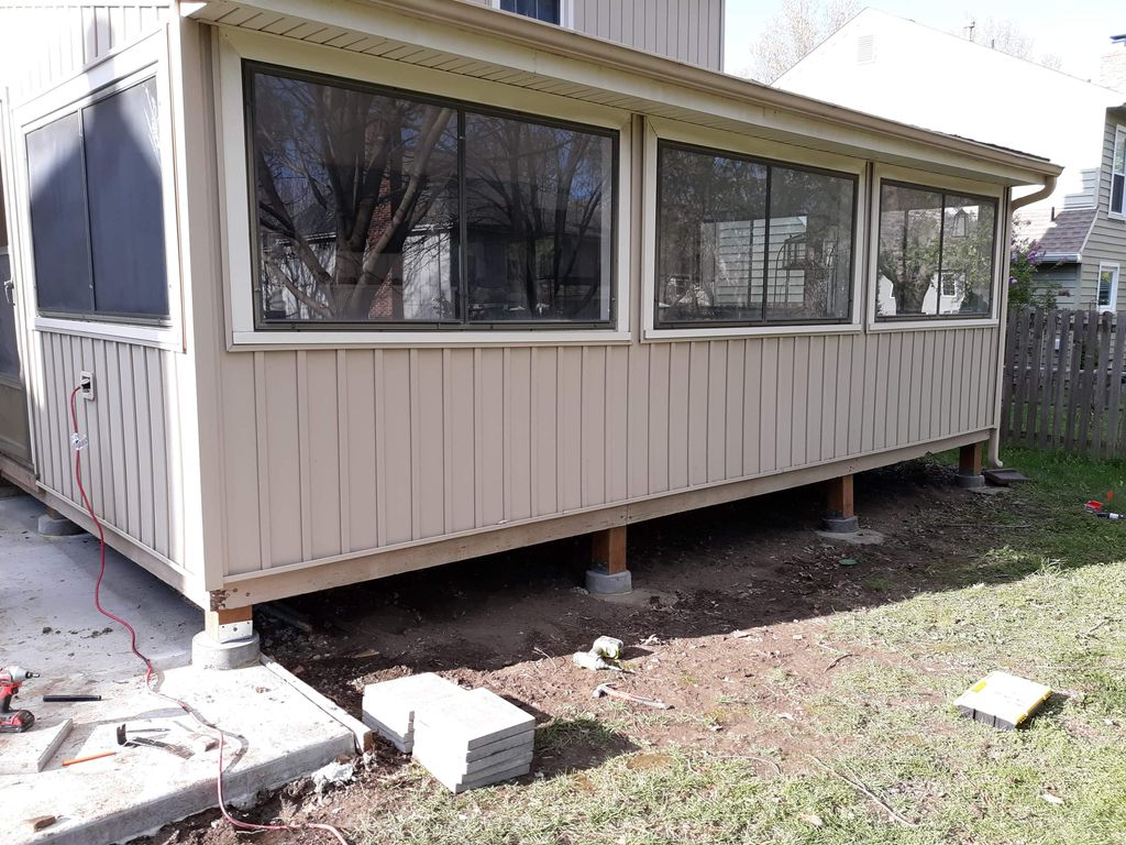 Leveling structure, new windows, removing inside wall landscaping