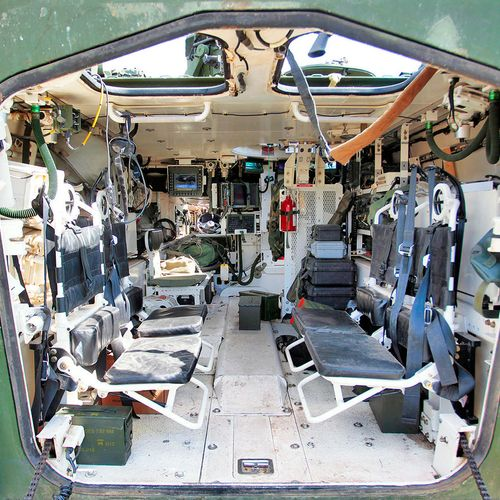Troop seat for the Styker military vehicle
