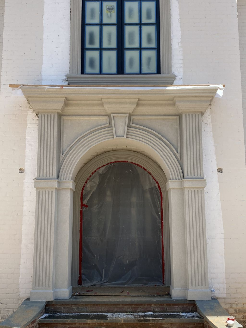 New stucco front entry with window, door bands