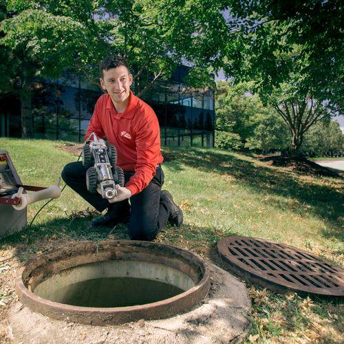 Technician using crawler cam in manhole. Crawler, Sewer, Manhole, Camera