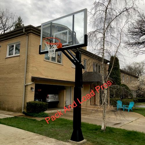 Basketball hoop in ground installation in River Forest Illinois.
