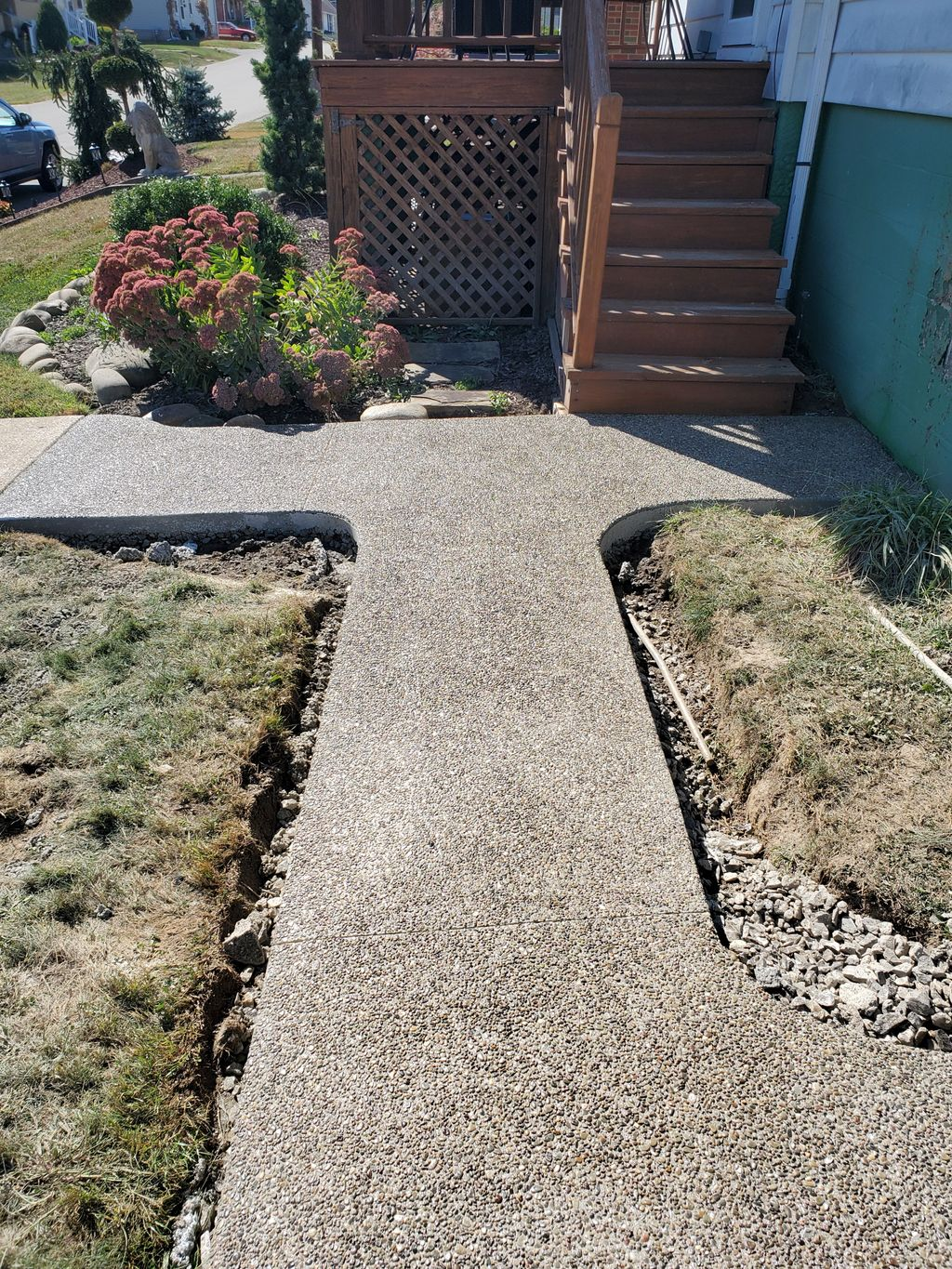 exposed sidewalk, paver and hardscape and concrete driveway