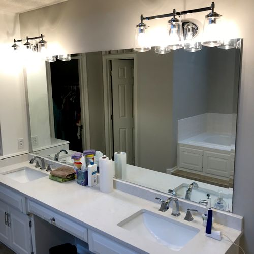 Replaced lighting and faucets