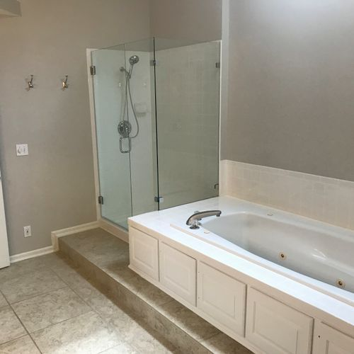 Painted Bathroom, replaced fixtures, repaired tile and refreshed grout