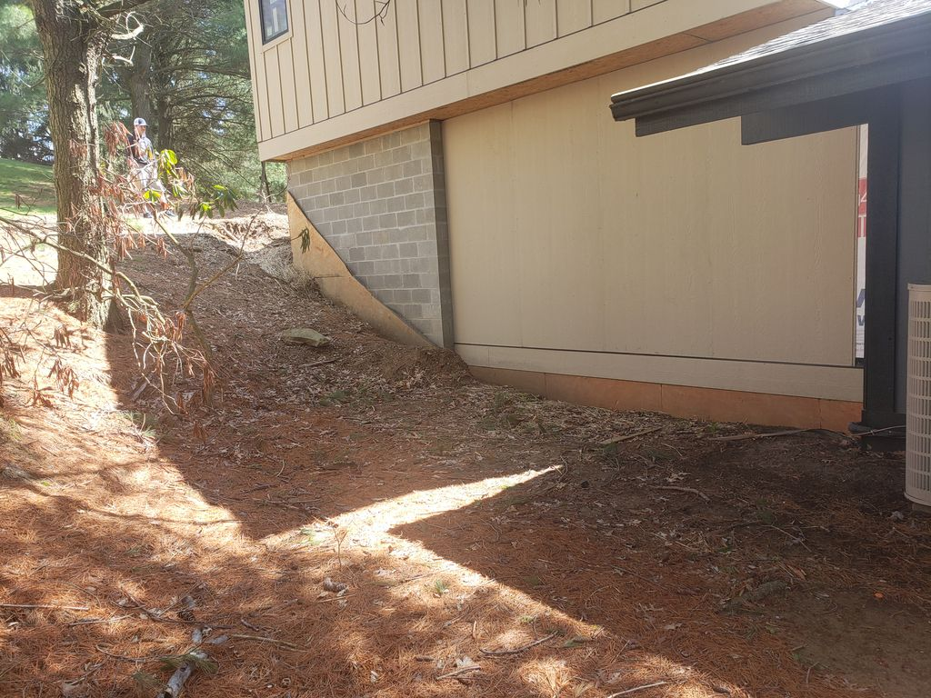 General Landscaping on Hillside with Storm Water Retention Sump
