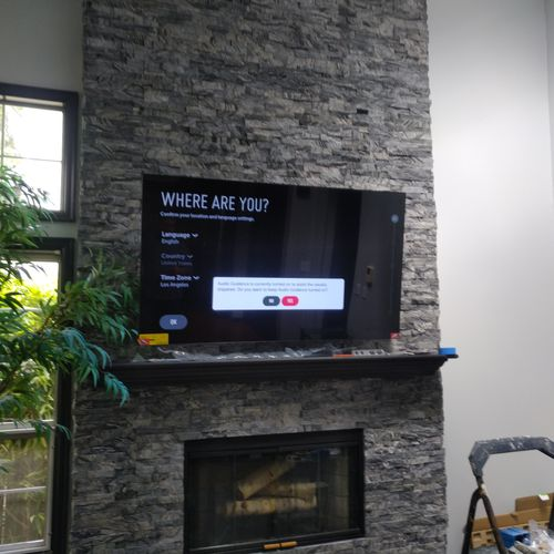 Stone all the way up to ceiling and tv installed