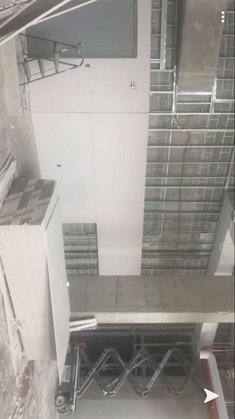 Drywalling dwarf district building