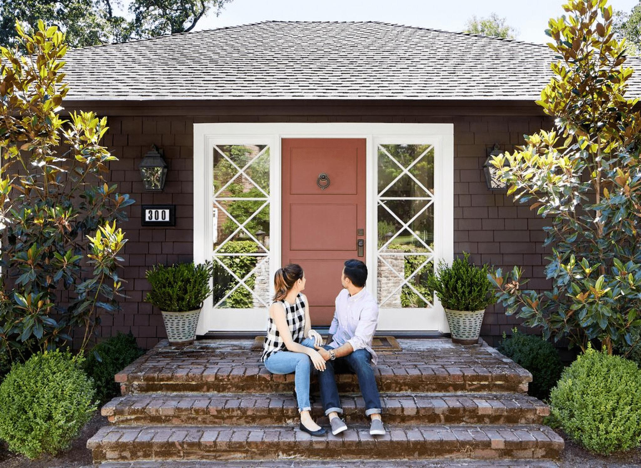 couple in front of front door