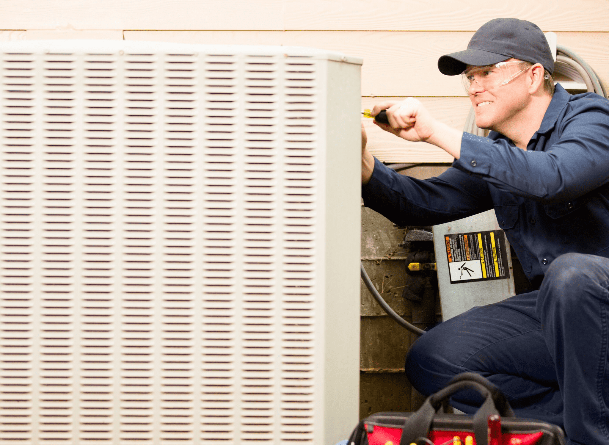 HVAC specialist repairing outside unit