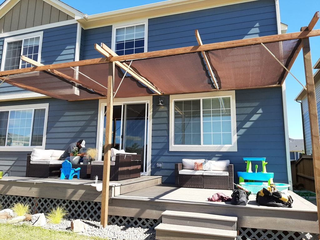 Multi-level Trex Deck and pergola with retractable shade screens