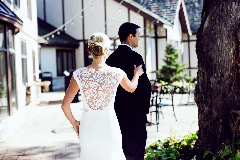 bride tapping on groom's shoulder