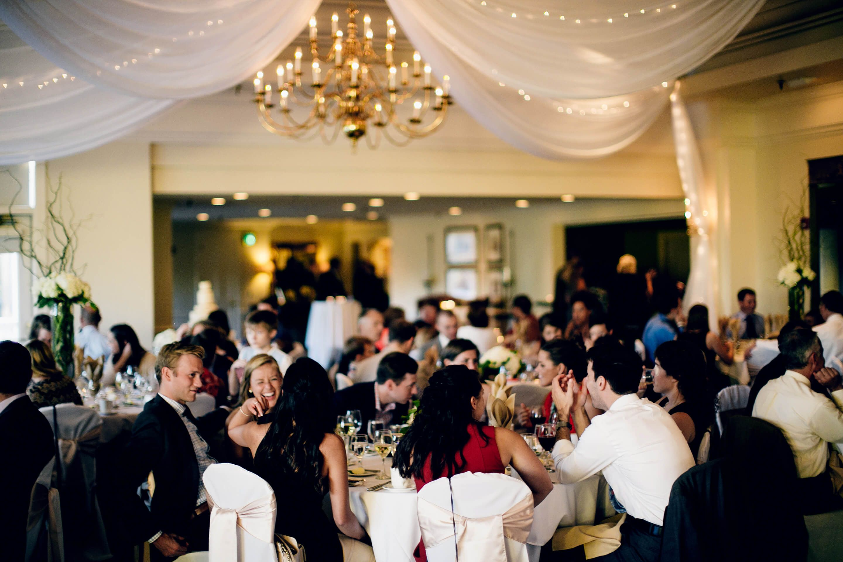 people sitting down at wedding reception