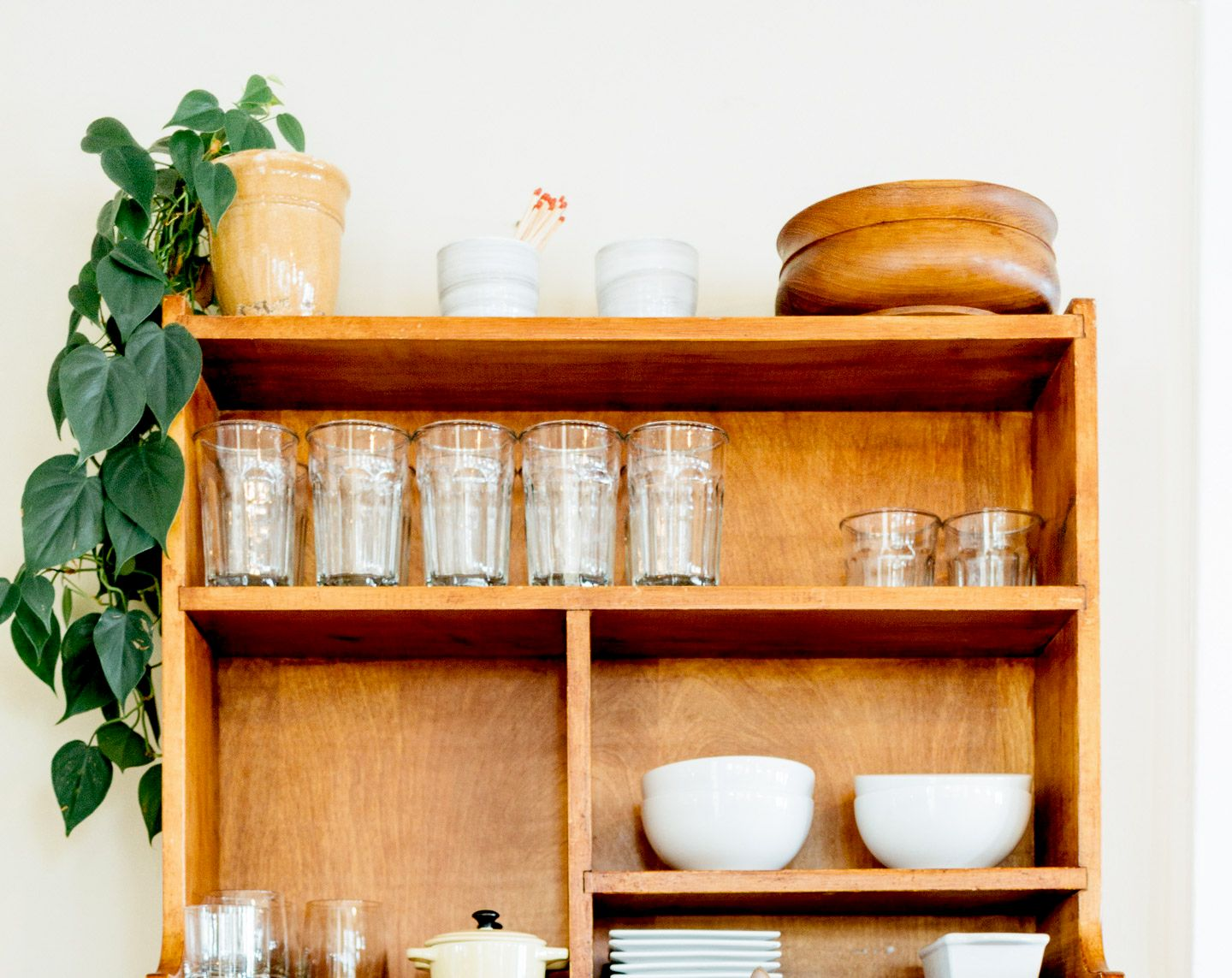 organized dishes in cupboard