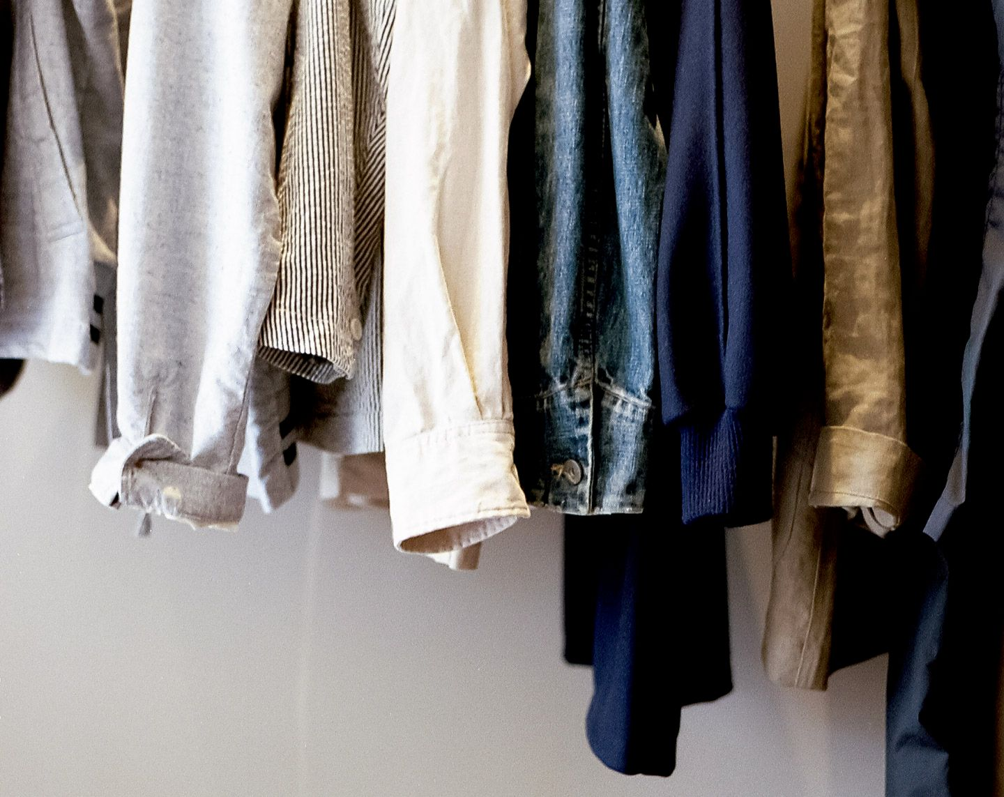 shirts and jackets hanging in closet