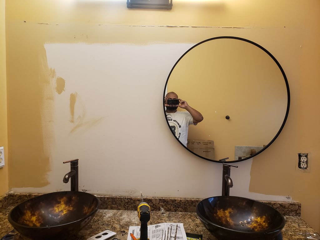 Remove single  and install 2 oval mirrors