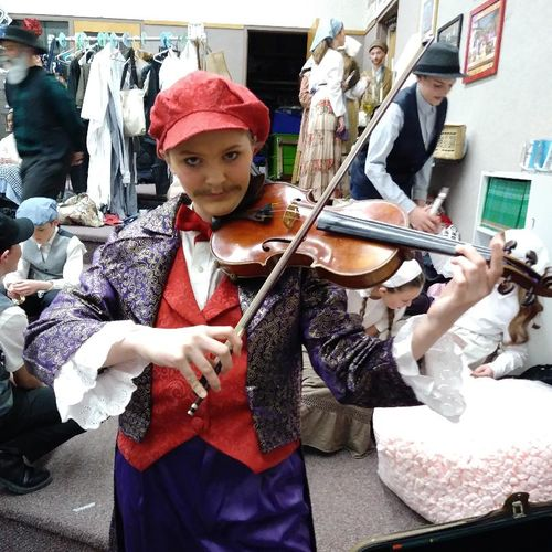 Student playing the fiddler in their school's production of Fiddler on the Roof!