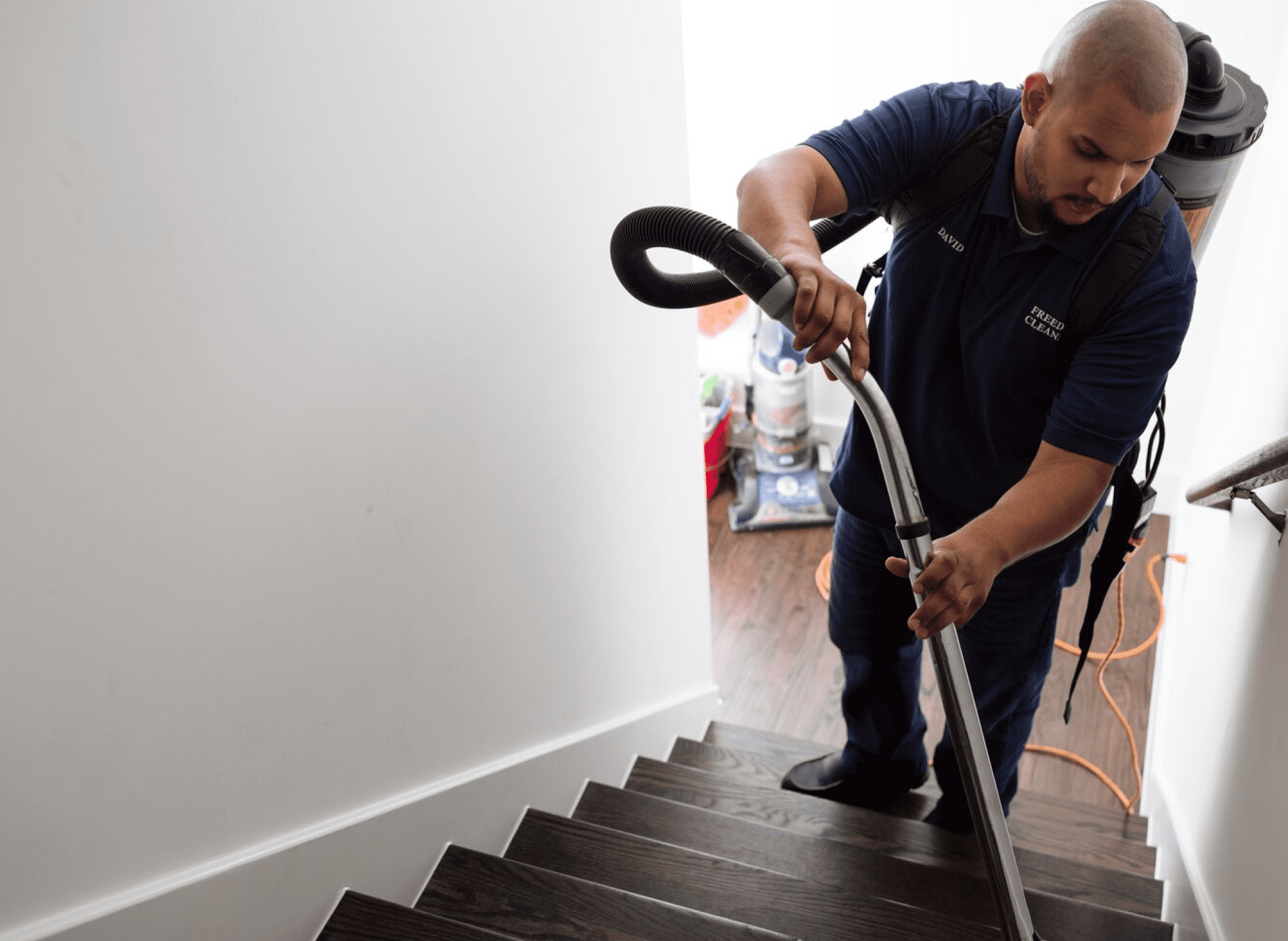 house cleaner vacuuming stairs
