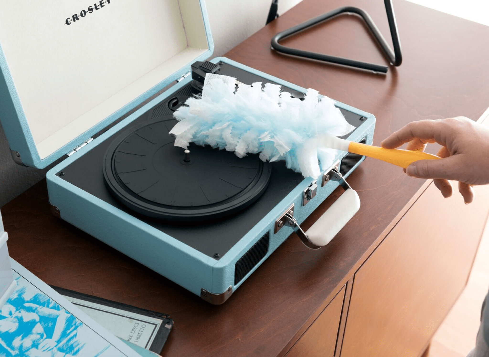 dusting a record player