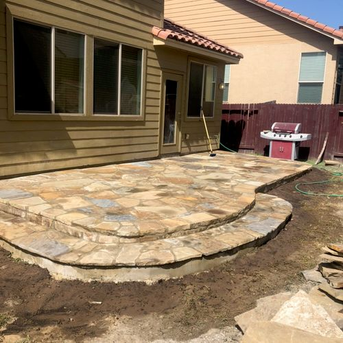 After... 26x12 flagstone patio. Clients were extremely happy!