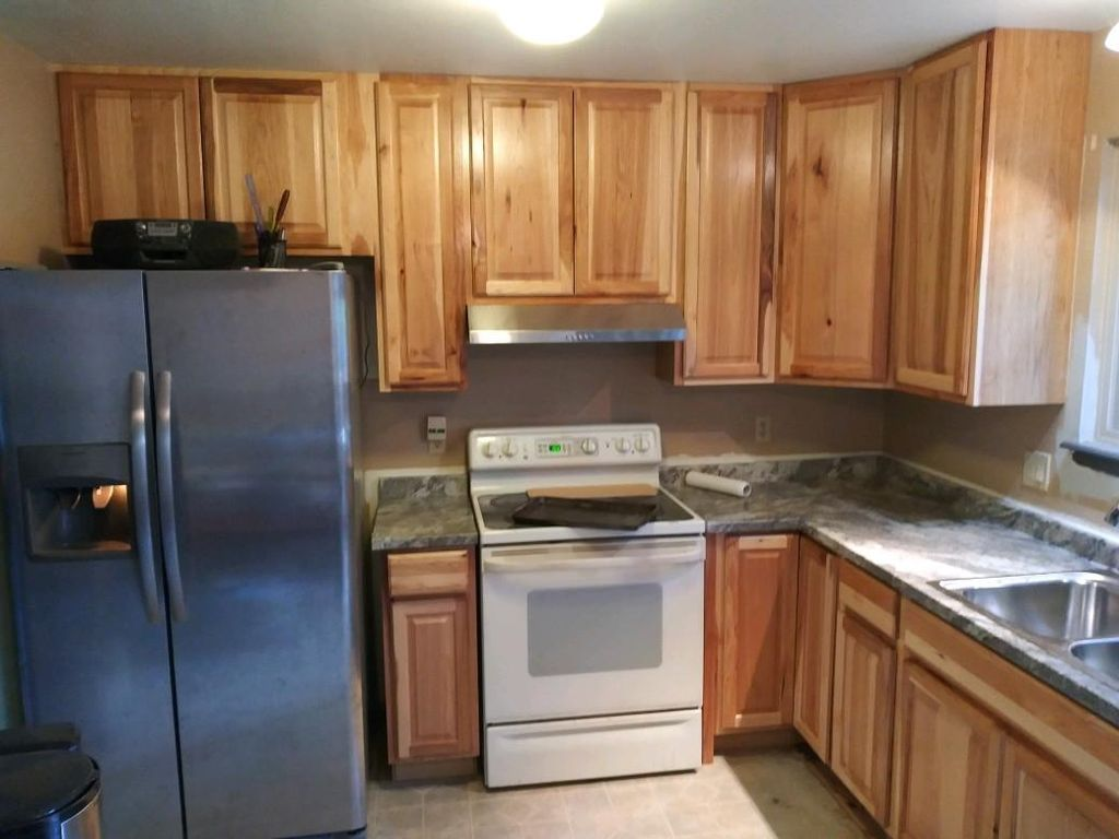 Replaced cabinets, hood range,countertops