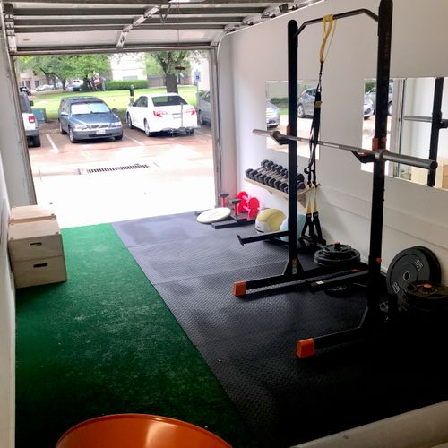 Private, garage gym. Complete with squat rack, barbell, dumbbells, TRX, medicine balls, plyo boxes, mats, resistance bands and more!