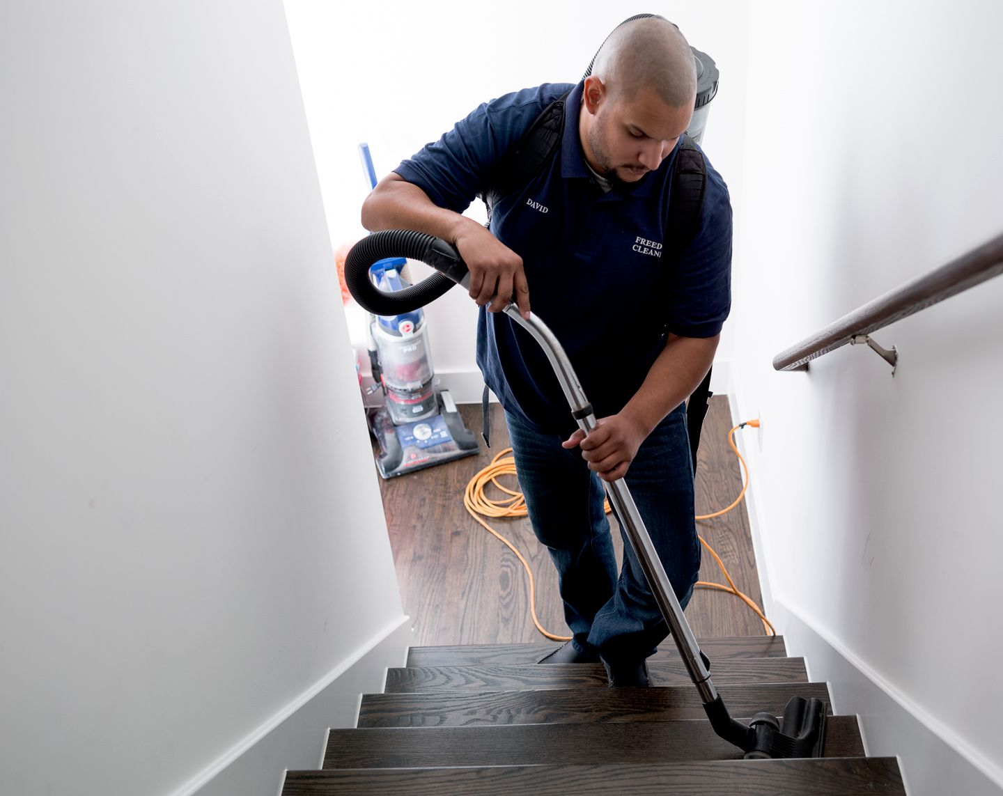 man steam cleaning stairs