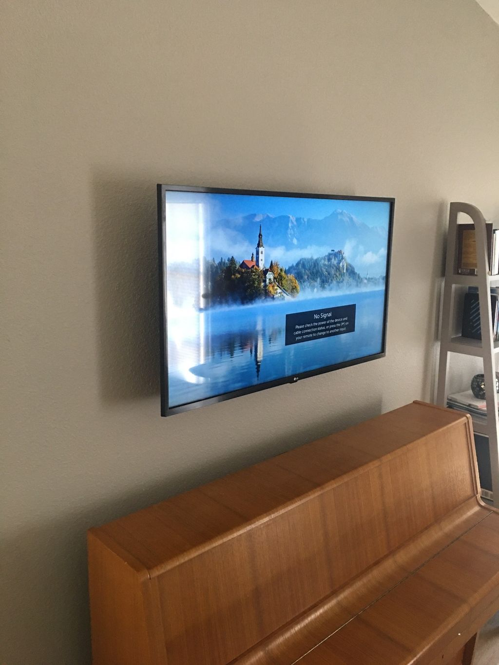 40 inch tv install with wire concealment above piano
