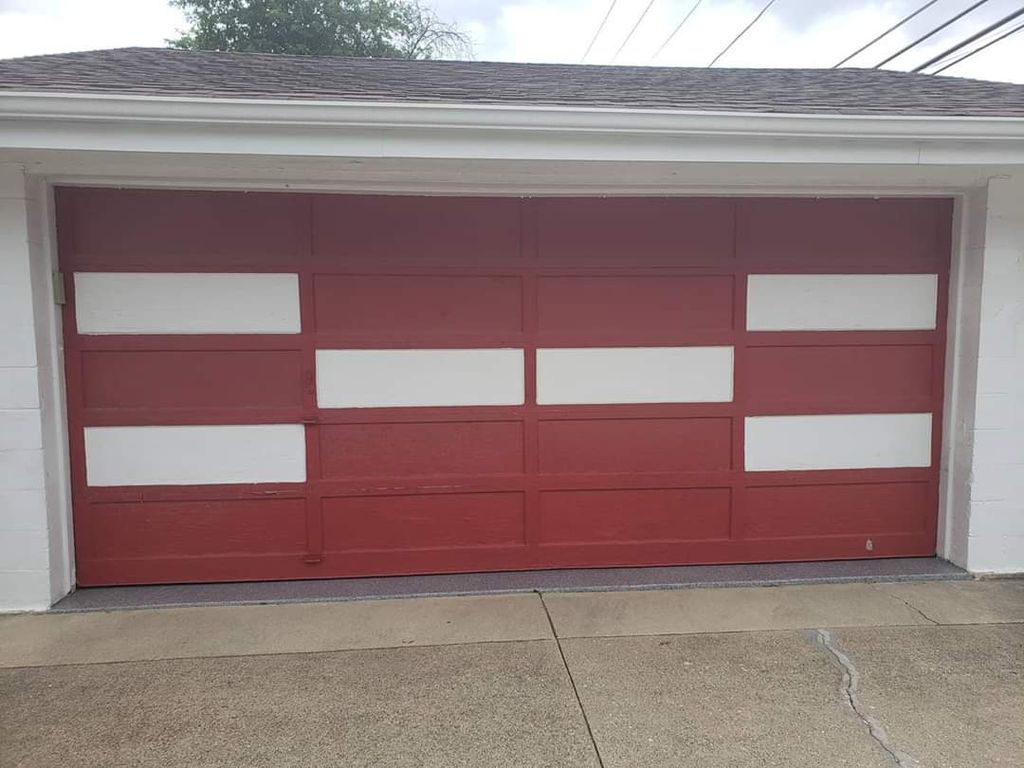 garage  door non  insulated and opener two remotes and keypad are