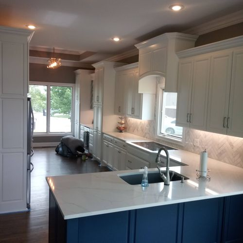 painted brand new kitchen in Lees Summit.  white cabinets navy blue island