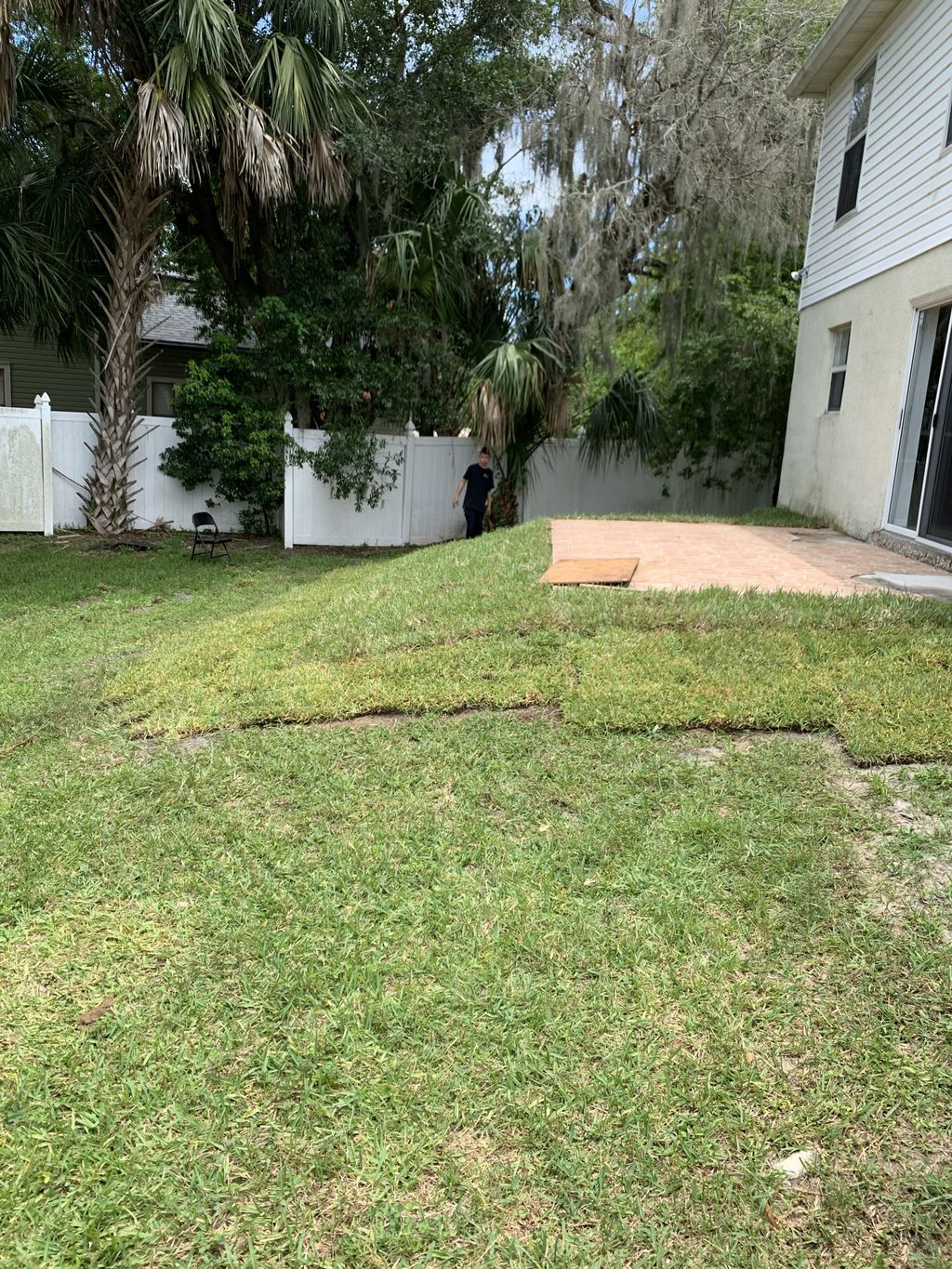 Back yard sod installation and grading