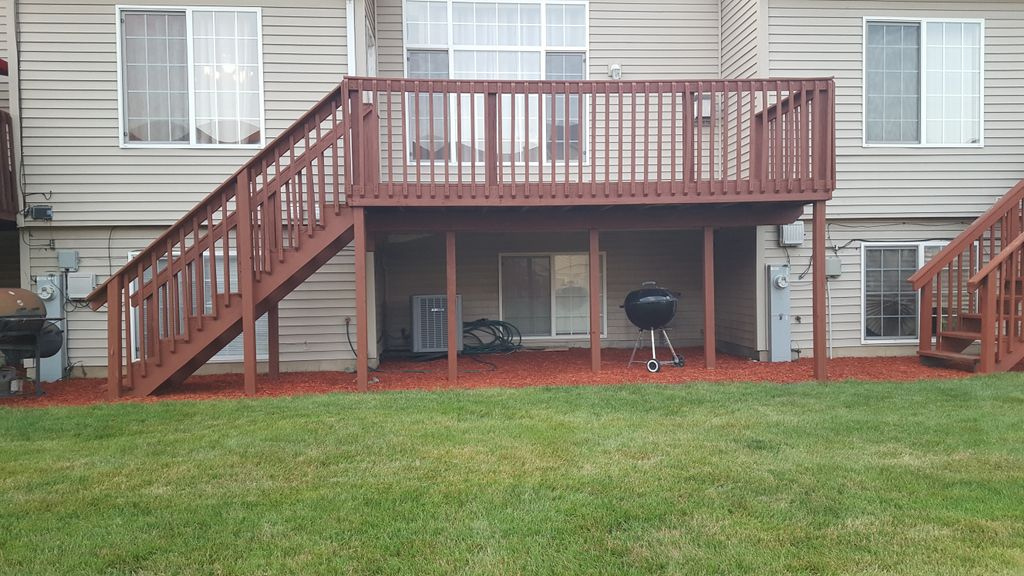 Outdoor deck staining with stairs and rails