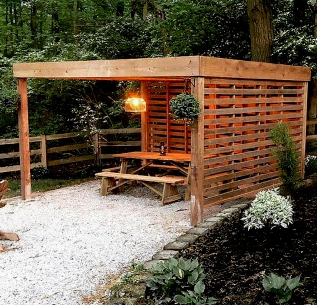 Outdoor sitting area with fixed privacy louvers