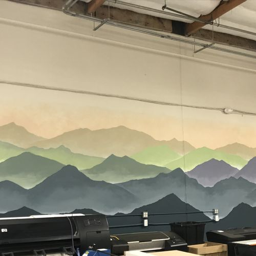 Mountain mural in a warehouse