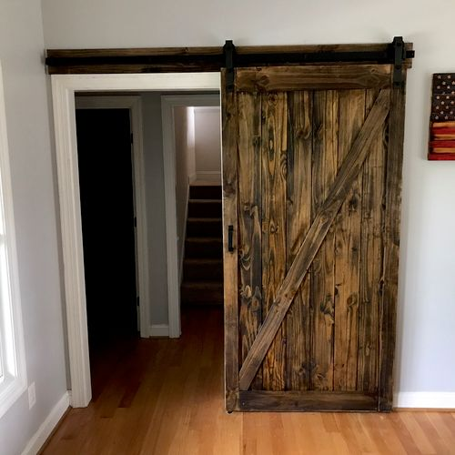 Barn door, stained to the customer specifications off site then installed