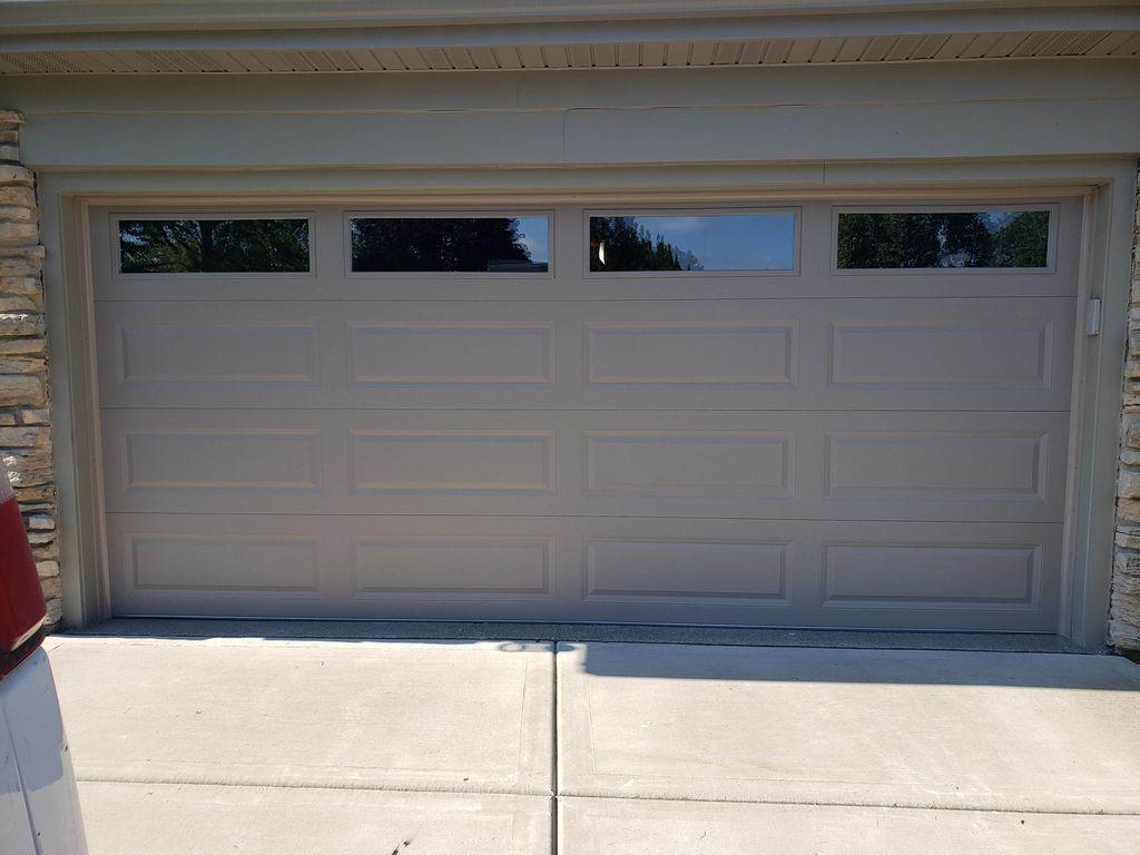 garage door with windows and garage door opener