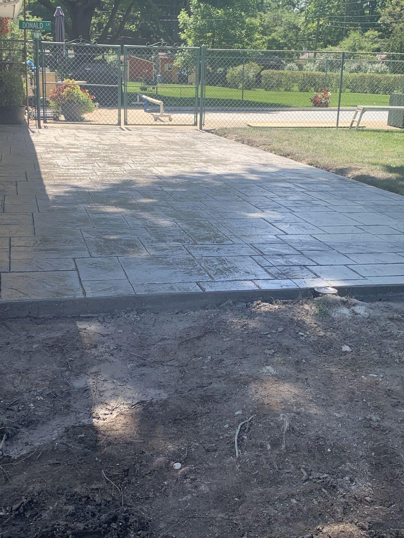 Stamped patio driveway parking pad basketball pad