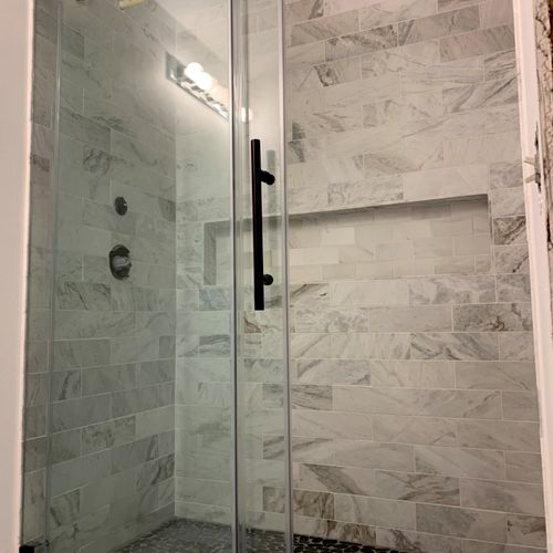 Black river stone shower floor