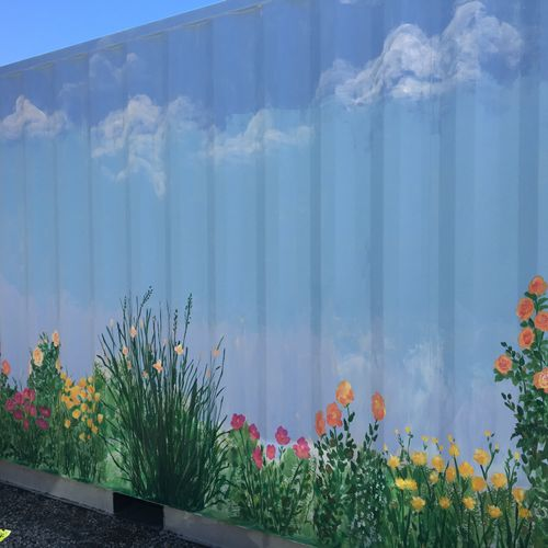Garden on the side of a storage container.