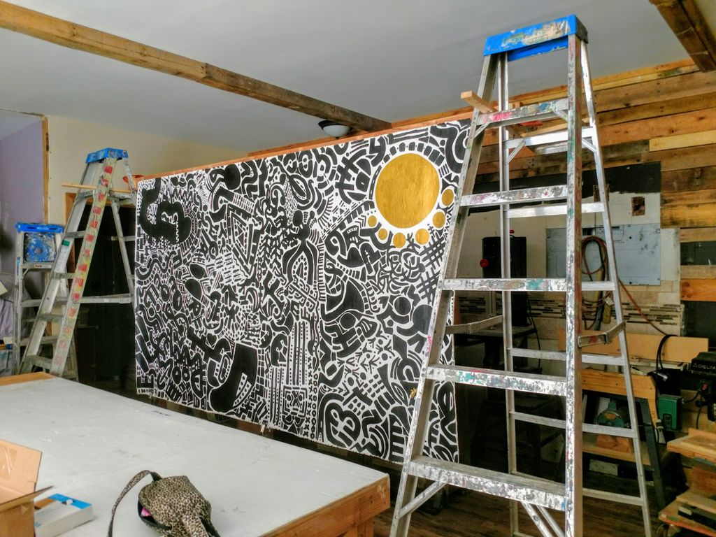 Create a hanging system for a large original canvas
