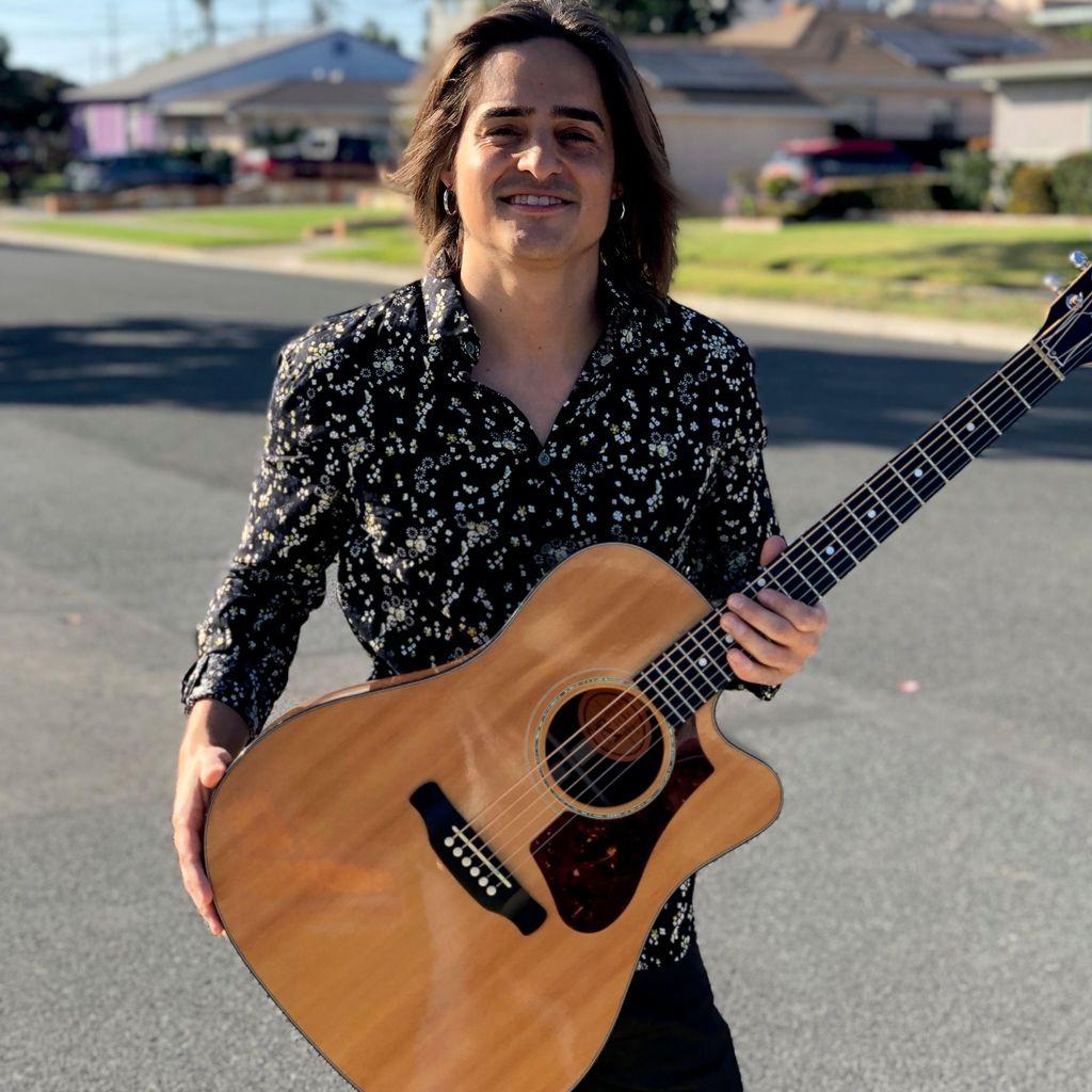 Brandon Paul | Singing guitarist & teacher
