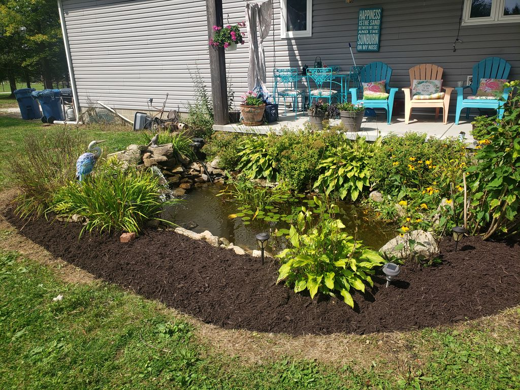 Mulching, edging, and weeding beds