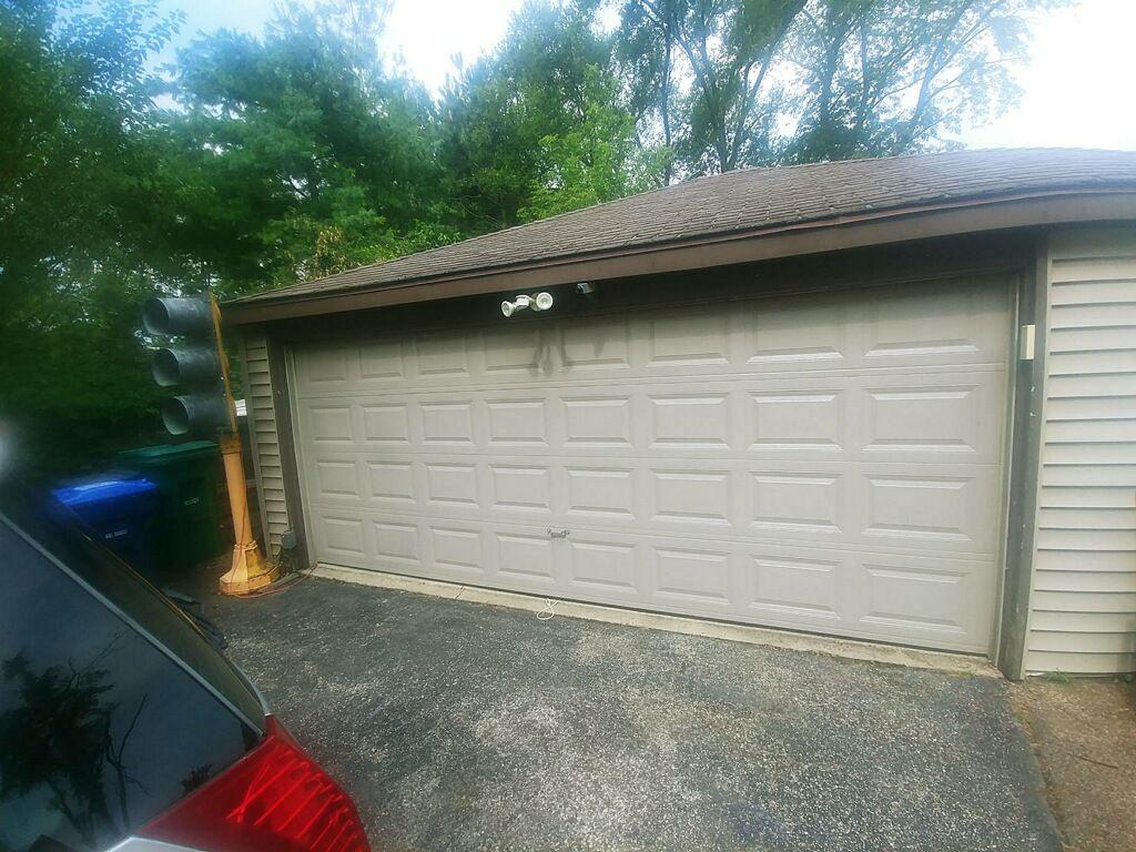 Installation of new 2 car garage  raised short panel