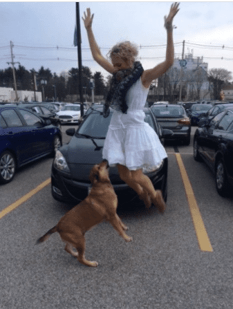 """KC and""""Piper,"""" jumping for joy at Mazda. The dealership in New Hampshire used this photo for their marketing and advertisements. :)"""