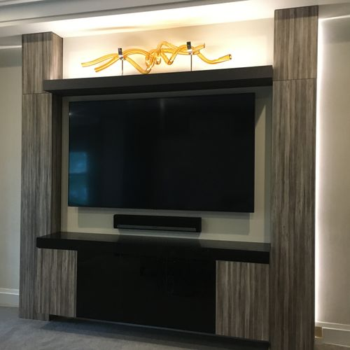 after tv wall unit with lighting and storage